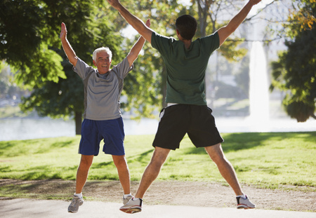 jacks: Older men doing jumping jacks outdoors LANG_EVOIMAGES
