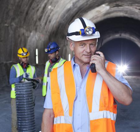 outdoor lighting: Businessman using walkie-talkie in tunnel