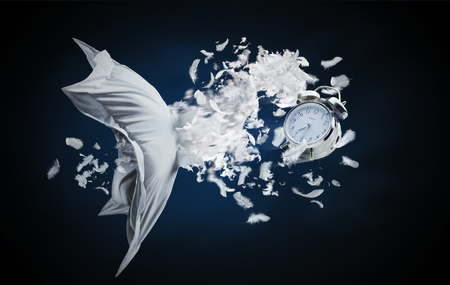 blasting: Alarm clock blasting through feather pillow LANG_EVOIMAGES