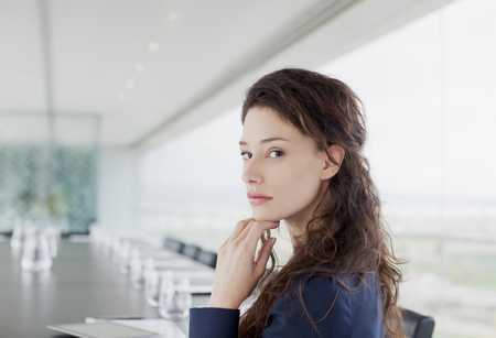 turning table: Portrait of serious businesswoman in conference room LANG_EVOIMAGES