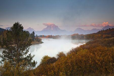 Mist over river in rural landscape