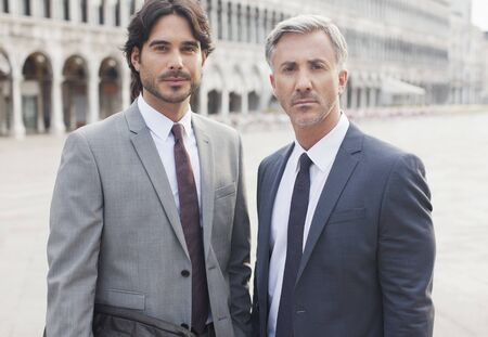 business: Portrait of confident businessmen in St. Marks Square in Venice LANG_EVOIMAGES