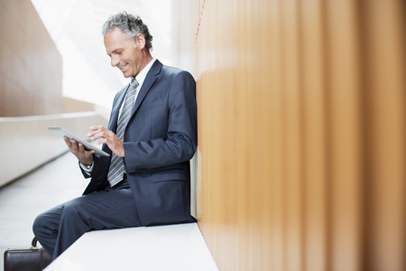 electronic book: Businessman using digital tablet in office