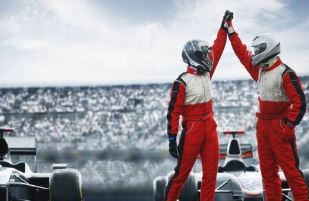 formula one: Racers cheering on track LANG_EVOIMAGES