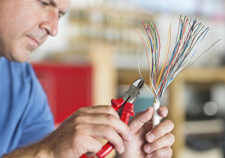 people: Electrician trimming wires