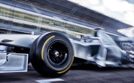 formula one: Race car driving on track LANG_EVOIMAGES