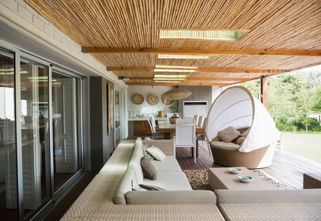 sectional door: Sofa and chairs on modern patio LANG_EVOIMAGES