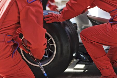 impact wrench: Racing team working at pit stop