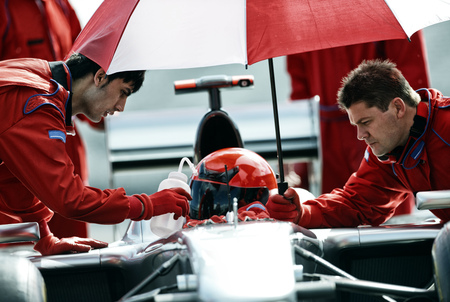 formula one: Racer and team working in pit stop