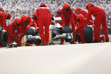Race car team working at pit stop LANG_EVOIMAGES