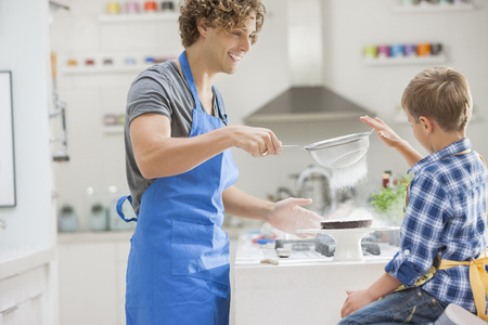 Father and son baking in kitchen LANG_EVOIMAGES