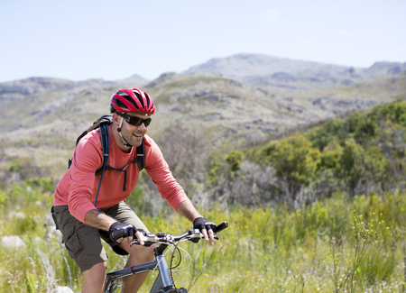 transportation: mountain biker in rural landscape