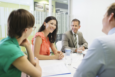 brazilian ethnicity: Business people talking in meeting