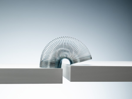 Metal slinky spanning space between blocks