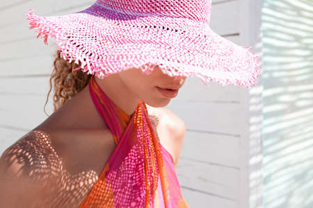 sunhat: Woman wearing sunhat outdoors LANG_EVOIMAGES