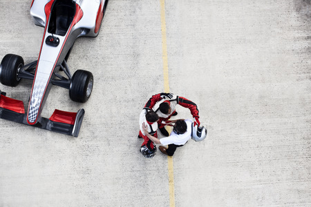 formula one: Racing team hugging on track LANG_EVOIMAGES