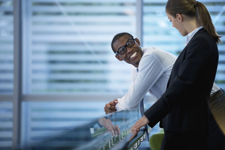 Smiling businessman and businesswoman talking