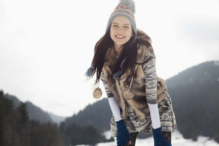 looking away from camera: Portrait of happy woman in snow LANG_EVOIMAGES