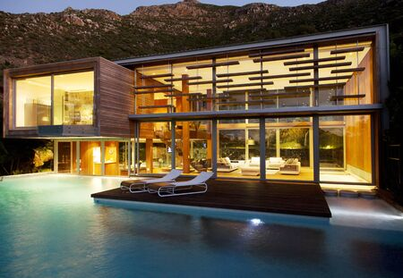 Swimming pool and modern house at night