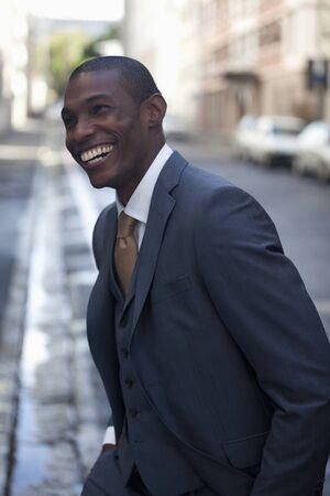 jamaican ethnicity: Happy businessman walking in street