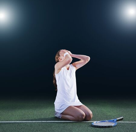Tennis player crying on court LANG_EVOIMAGES