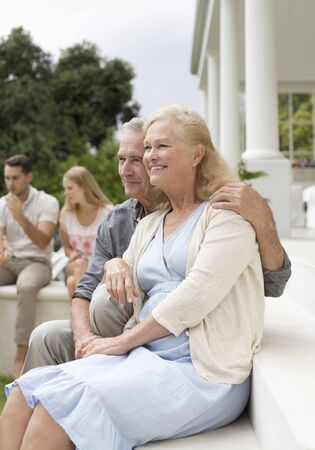 Older couple sitting on porch