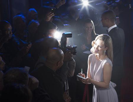 Female celebrity signing autographs LANG_EVOIMAGES