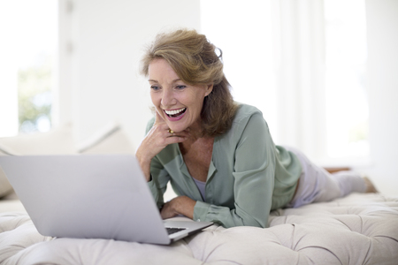 silver surfer: Senior woman using laptop in living room