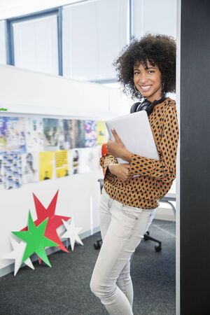 Portrait of smiling businesswoman in office LANG_EVOIMAGES
