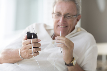 stylus: Older man using cell phone LANG_EVOIMAGES