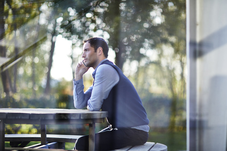 Businessman talking on cell phone outside LANG_EVOIMAGES