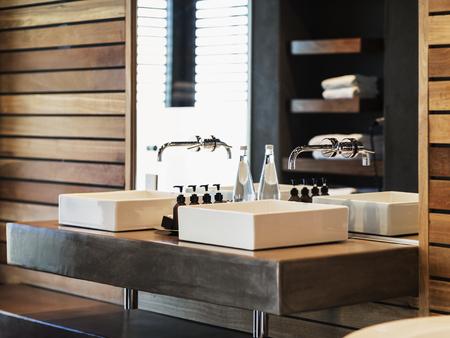bathroom mirror: Sinks and mirror in modern bathroom