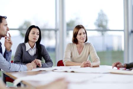vietnamese ethnicity: Business people talking in meeting