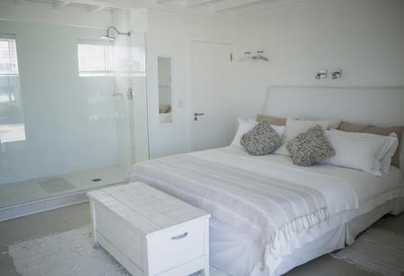 hotel bedroom: Bed, shower and trunk in modern bedroom
