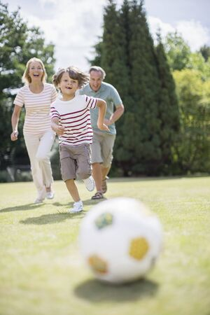 level playing field: Grandparents and grandson playing soccer