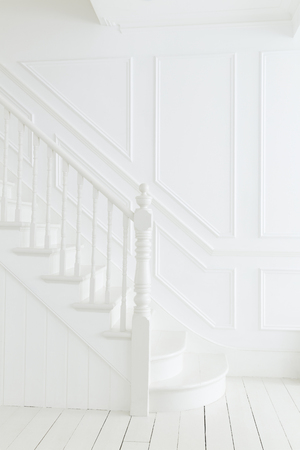 Banister and staircase in white foyer LANG_EVOIMAGES