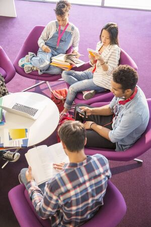 University students reading in lounge