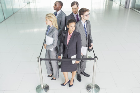 Business people standing in roped-off square