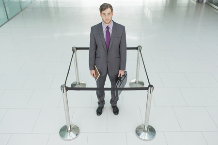 Businessman standing in roped-off square