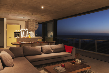 sectional door: Sofa and dining table in modern living room overlooking ocean LANG_EVOIMAGES