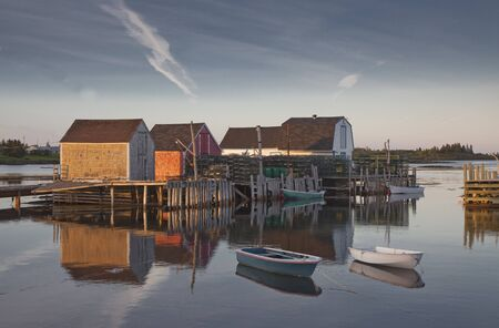 rowboats: Rowboats and buildings on calm bay
