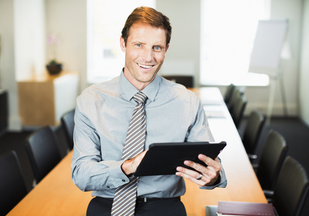 business: Businessman using digital tablet in office