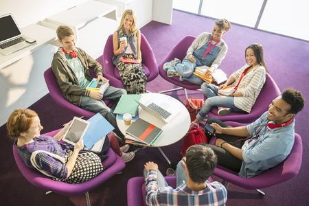 round chairs: University students talking in circle