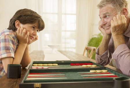 backgammon: Grandfather and grandson playing backgammon