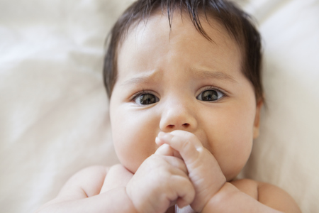 fussy: Fussy baby girl sucking her thumb