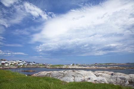 newfoundland: Blue sky and clouds over craggy harbor