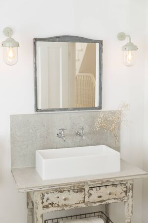 antique furniture: Sink and drawers in luxury bathroom LANG_EVOIMAGES