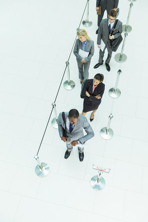 Business people waiting in line LANG_EVOIMAGES