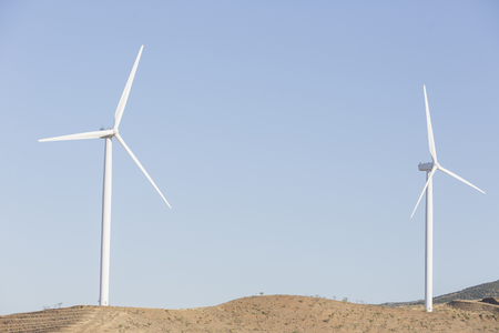 carbon neutral: Wind turbines spinning in rural landscape