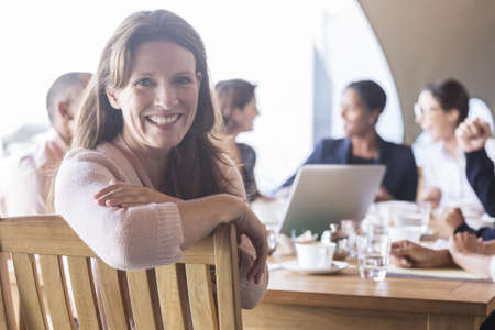 turn table: Businesswoman smiling in meeting
